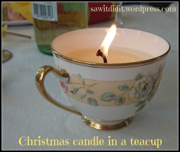 Christmas candle in a teacup